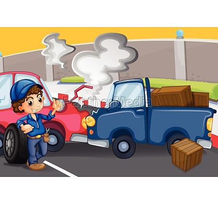 a mechanic boy near the cars