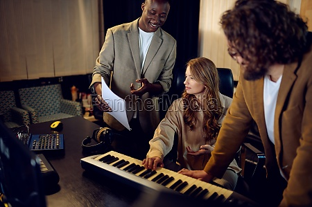 male and female performers recording studio