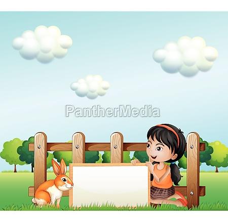 a girl holding a framed banner