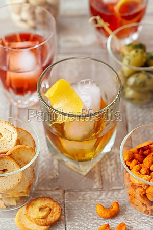 alcoholic drinks and salty snacks