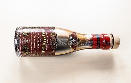 old glass bottle of aged giusti