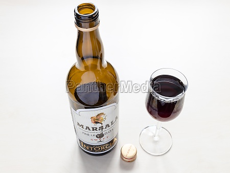 wine glass and open bottle of