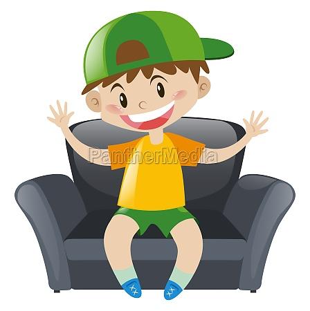 boy sitting on gray armchair