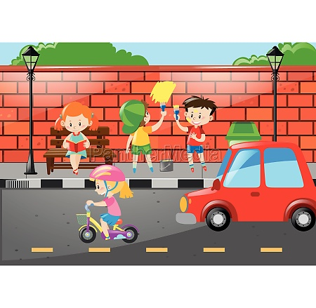 children painting wall by the road