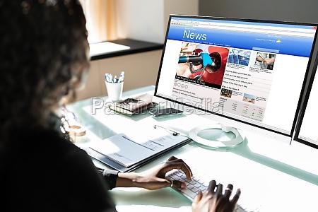 black woman watching news online