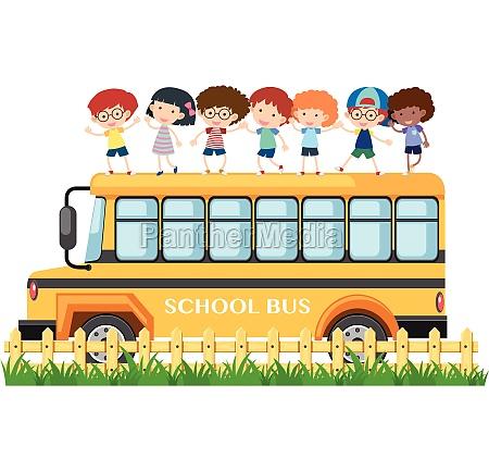 many kids standing on school bus