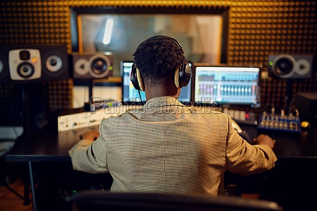 male sound engineer at mixing consol
