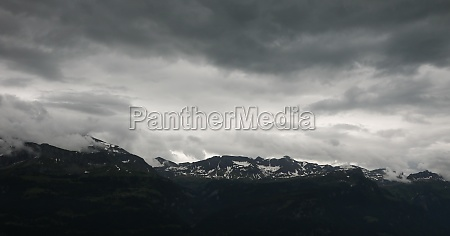 monochrome image of dark clouds over
