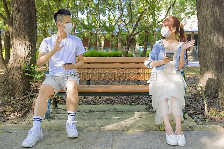 young couple in social distancing and