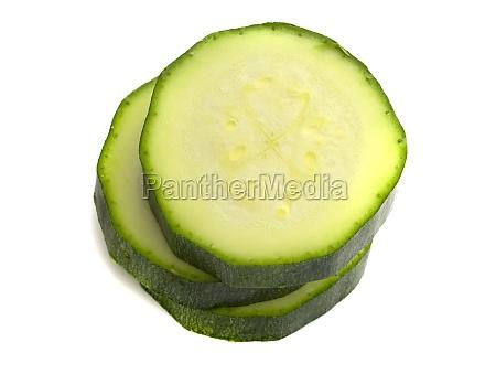 sliced zucchini isolated on white background