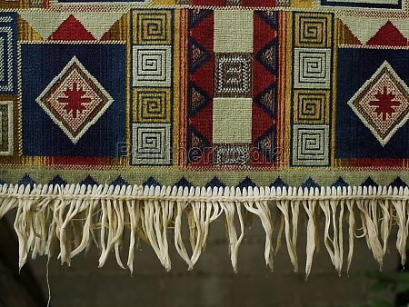 colored rug with fringe