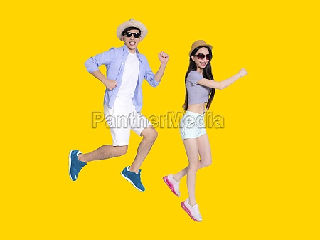 happy young couple in sunglasses and