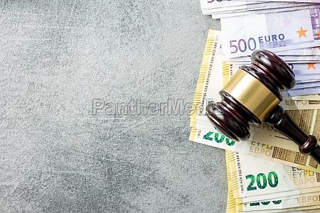 euro banknotes and judge gavel