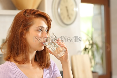 woman drinking tap water in the