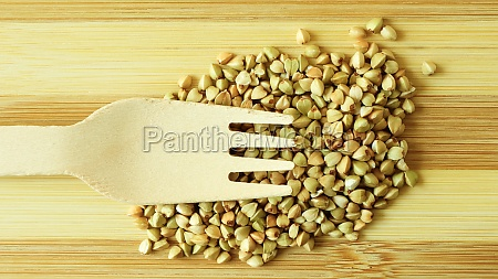 raw green organic buckwheat on a
