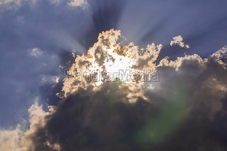 the suns rays break through the