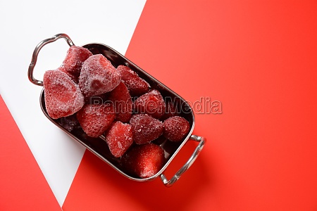 frozen strawberries in silver bowl on