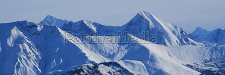 snow covered mountain peaks seen from