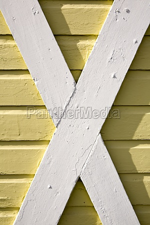 building exterior wood cladding cross beams