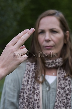 woman focussing on the hands of