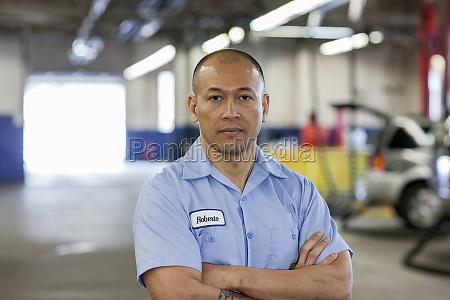 portrait of pacific islander car mechanic