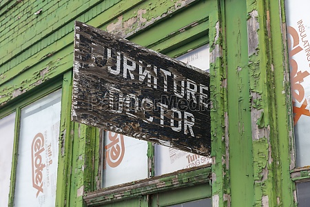 abandoned business furniture doctor sign above