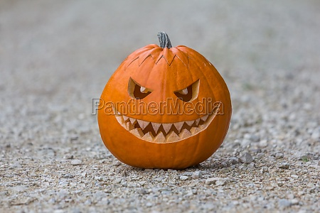 scary smiling halloween pumpkin with nasty