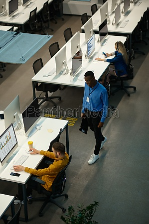 managers works on computers workplace in