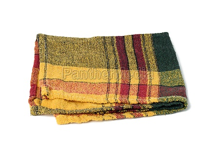 folded green yellow linen towel on