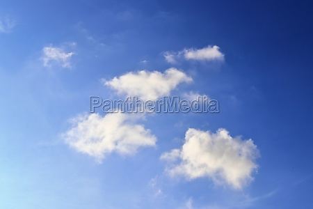 beautiful fluffy white cloud formations in