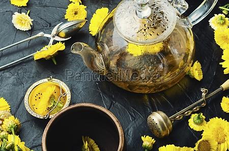 glass teapot with flower tea herbal