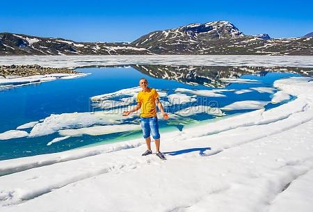 traveler tourist at frozen turquoise lake