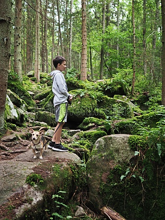 young boy walks the small dog