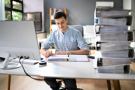 young businessman working at office with