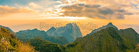 panoramic beautiful mountain peaks topped with